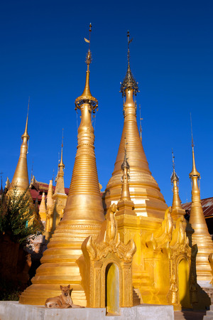 reconstructed: Shwe Inn Thein Pagoda Complex in Shan State, Myanmar. Inn Thein is a temple complex of over 1,000 structures. Weather-beaten buddhistic zedi constructed in 17th and 18th century damaged by earthquake in 1975, partitialy back reconstructed.