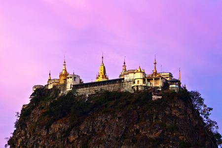 Taungkalat monastery at Mount Popa view at sunrise, Myanmar. Mount Popa is a volcano 1518 metres above sea level, and located in central Myanmar about 50 km southeast of Bagan in the Pegu Range.