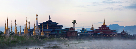 Ancient buddhist pagoda and monastery over mist on Inle lake, Shan state, Myanmar Stock Photo
