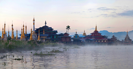 Ancient pagoda and monastery at sunrise on Inle lake, Shan state, Myanmar Stock Photo