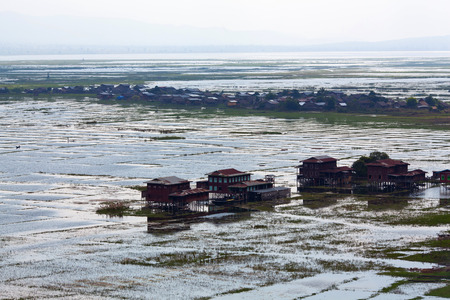 poling: Village on wooden piles of Intha people over water on Inle lake, Shan state, Myanmar Stock Photo