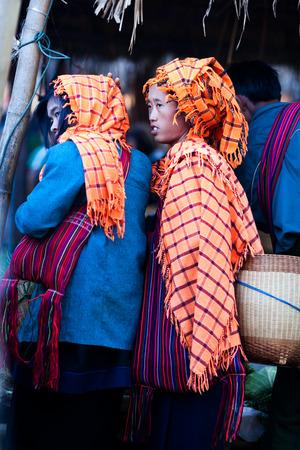 weekly market: SAMKAR, MYANMAR - JANUARY 15: Pa-O tribal woman in native costume walking at weekly market on January 15, 2011 in Samkar Village, Shan state, Myanmar