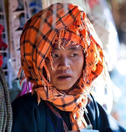 pao: SAMKAR, MYANMAR - JANUARY 15: Pa-O tribal woman in native costume walking at weekly market on January 15, 2011 in Samkar Village, Shan state, Myanmar
