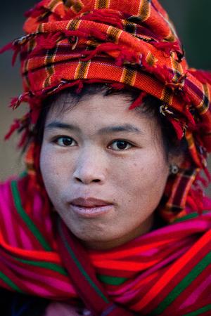 pao: SAMKAR, MYANMAR - JANUARY 17: Pa-O tribal woman in native costume walking at weekly market on January 17, 2011 in Samkar Village, Shan state, Myanmar