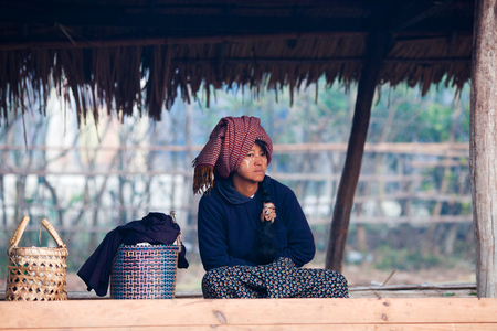pao: SAMKAR, MYANMAR - JANUARY 17: Pa-O tribal woman in native costume are sitting at weekly market on January 17, 2011 in Samkar Village, Shan state, Myanmar