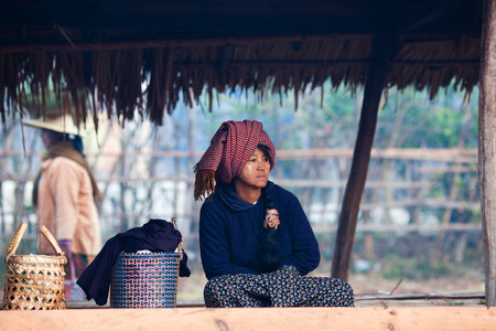 pao: Pa-O tribal woman in native costume are sitting at weekly market on January 17, 2011 in Samkar Village, Shan state, Myanmar