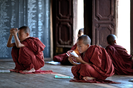 yan: Novice monks learning in the Shwe Yan Pyay monastery school on January 16, 2011 in Nyaung Shwe, Shan State, Myanmar