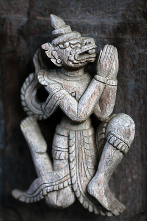 arhitecture: Ancient carved wooden figure at Shwe Nan Daw Kyaung (Golden Palace Monastery) in Mandalay, Myanmar. Golden Palace monastery is 19th Century Kon Baung Era Architectural Work. The carved is over 100 years old.