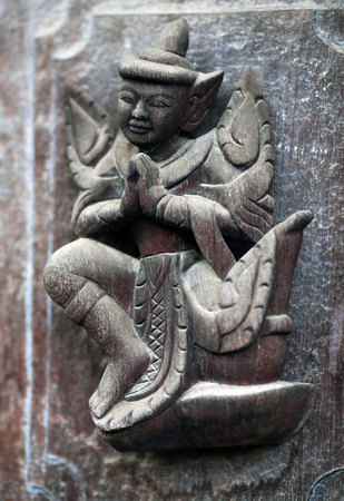 daw: Ancient carved wooden figure at Shwe Nan Daw Kyaung (Golden Palace Monastery) in Mandalay, Myanmar. Golden Palace monastery is 19th Century Kon Baung Era Architectural Work. The carved is over 100 years old.