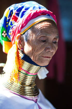 necked woman: Padaung Tribal woman poses for a photo on January 16, 2011 in Ywama village, Shan State, Myanmar. Editorial