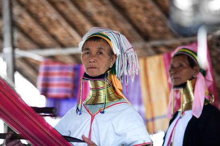 Two Padaung Tribal woman poses for a photo on January 5, 2011 in Myinkaba Village, Bagan, Myanmar. The Padaung-Karen long-necked tribe women are minority of Myanmar exploited for tourism reasons. Editorial