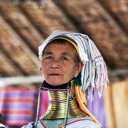 exploited: Padaung Tribal woman poses for a photo on January 5, 2011 in Myinkaba Village, Bagan, Myanmar. The Padaung-Karen long-necked tribe women are minority of Myanmar exploited for tourism reasons. Editorial