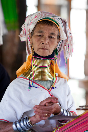 Padaung Tribal woman poses for a photo on January 5, 2011 in Myinkaba Village, Bagan, Myanmar. The Padaung-Karen long-necked tribe women are minority of Myanmar exploited for tourism reasons. Editorial