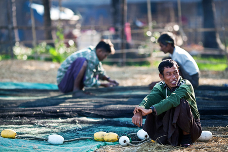 boatman: Burmese fishermen working at Bengal Bay on January 21, 2011 in Ngapali, Myanmar Editorial