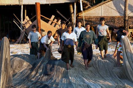boatman: Burmese fishermen working on January 21, 2011 in Ngapali, Myanmar Editorial