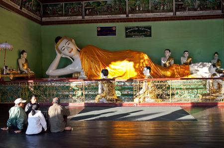 Pilgrims praying at Shwedagon Pagoda in Yangon, Myanmar