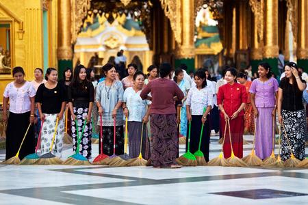 Burmese women washing the floor at  Shwedagon Paya during Shwesettaw Festival on January 26, 2011 in Yangon, Myanmar
