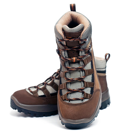 chamois leather: Mountain hiking boots isolated on the white background