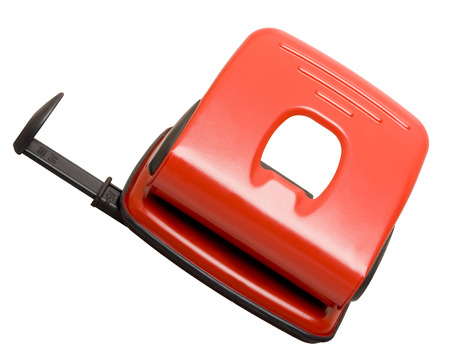 hole puncher: Red hole puncher isolated on the white background