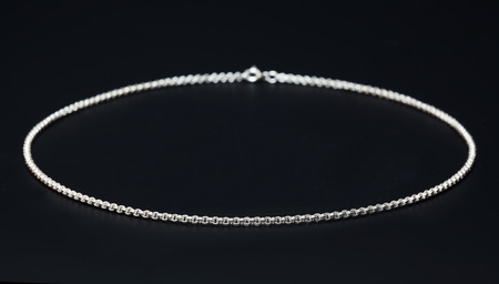 freshwater pearl: Sterling silver necklace close-up over dark background