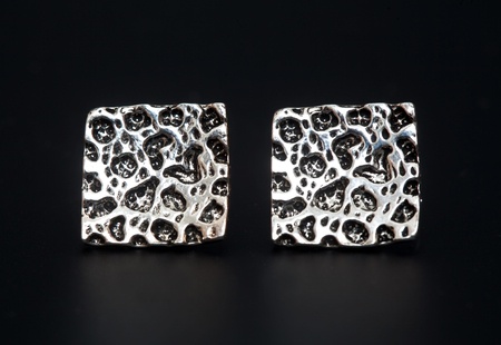 sterlina: Sterling silver earrings on the black background