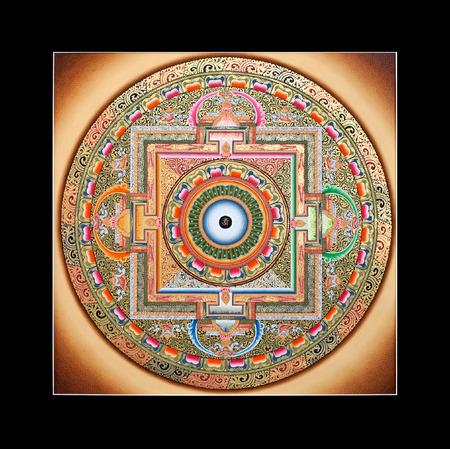 Ancient tibetan tangka Wheel of life (Ohm Mandala) isolated on the white background Stock Photo