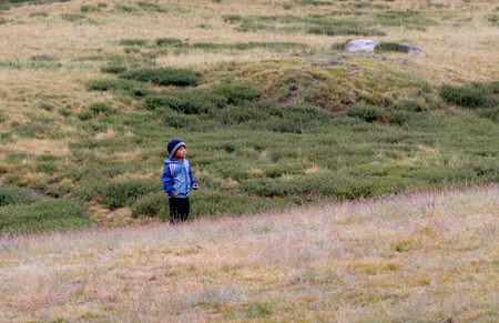 russia steppe: ALTAY, RUSSIA - JULY 24, 2007: Little Altay boy walking in steppe in Altay mountains, Russia. Editorial
