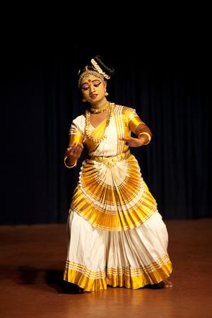 COCHIN, INDIA - FEBRUARY 17, 2010: Beautiful Indian girl dancing Mohinyattam (Dance of enchantress) in Fort Cochin, South India. Mohiniyattam is traditional South Indian dance from Kerala.