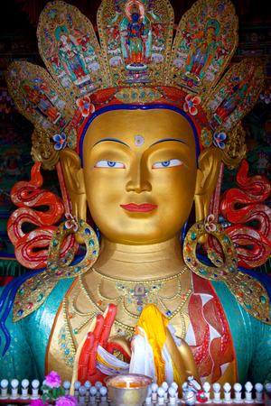 Famous beautiful sculpture of The Maitreya Buddha (Future Buddha) in Thiksey Gompa in Leh, Ladakh, Jammu and Kashmir, India Stock Photo