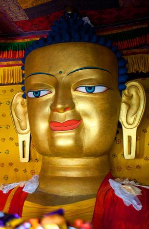 gautama buddha: Beautiful sculpture of Gautama Buddha at Shey Monastery in Leh, Ladakh, Jammu and Kashmir, India. The main Shakyamuni Buddha statue in the monastery is a 12 metres (39 ft) icon covering three floors of the monastery.