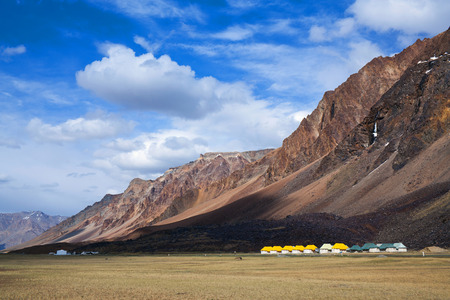 Sarchu camping tents at the Leh - Manali Highway. Leh - Manali Road is a highway in northern India connecting Leh in Ladakh in Jammu and Kashmir state and Manali in Himachal Pradesh state. Stock Photo