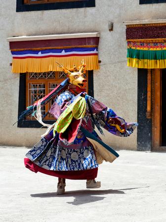 tantric: LAMAYURU, INDIA - JUNE 17, 2012: Buddhist monk in Deer mask dancing Cham mystery during Yuru Kabgyat festival at Lamayuru Gompa in Ladakh, Jammu and Kashmir, North India