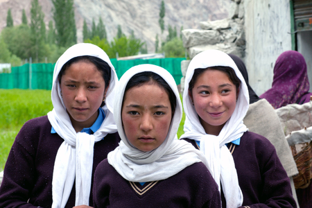 petite fille musulmane: Balti students poses for a photo during their break time on June13, 2012 in Turtuk Village, Ladakh, India