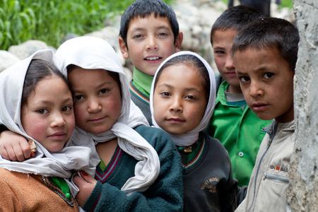 TURTUK, INDIA - JUNE 13, 2012: Children from Baltistan poses for a photo during her break time in Turtuk Village, Ladakh, India