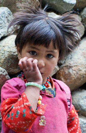 TURTUK, INDIA - JUNE 13, 2012: Girl from Baltistan poses for a photo during her break time in Turtuk Village, Ladakh, India
