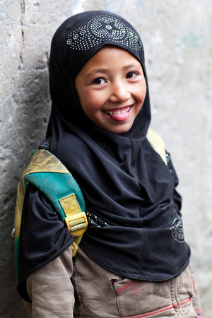 Muslim shoolgirl poses for a photo during her break time on June 13, 2012 in Turtuk Village, Ladakh, India. Turtuk village opened to foreign tourists in 2010. Editöryel