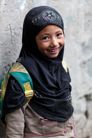 Muslim girl poses for a photo during her break time on June 13, 2012 in Turtuk Village, Ladakh, India. Turtuk village opened to foreign tourists in 2010. Editöryel