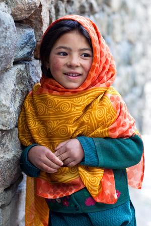 TURTUK, INDIA - JUNE 13: Balti schoolgirl poses for a photo during her break time on June13, 2012 in Turtuk Village, Ladakh, India