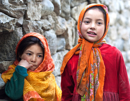 TURTUK, INDIA - JUNE 13, 2012: Shoolgirls from Baltistan poses for a photo during her break time in Turtuk Village, Ladakh, India