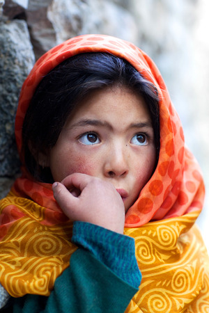 TURTUK, INDIA - JUNE 13, 2012: Shoolgirl from Baltistan poses for a photo during her break time in Turtuk Village, Ladakh, India