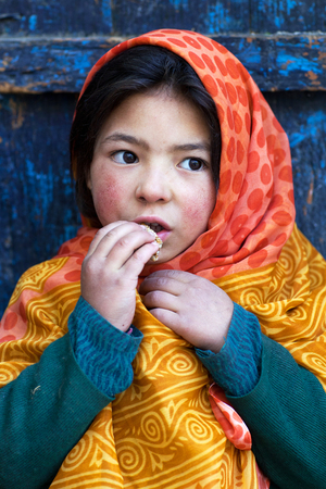 TURTUK, INDIA - JUNE 13, 2012: Shoolgirl from Baltistan poses for a photo during her break time in Turtuk Village, Ladakh, India