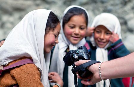TURTUK, INDIA - JUNE 13, 2012: Children from Baltistan poses for a photo during her break time in Turtuk Village, Ladakh, India