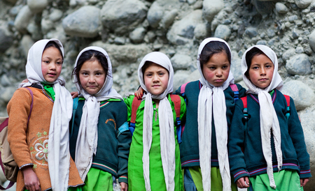 petite fille musulmane: Group of Balti students poses for a photo during their break time on June13, 2012 in Turtuk Village, Ladakh, India