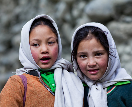 Two Balti students poses for a photo during their break time on June13, 2012 in Turtuk Village, Ladakh, India