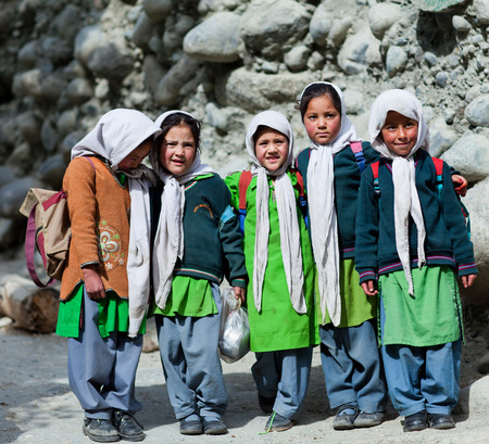 Children poses for a photo during their break time on June13, 2012 in Turtuk Village, Ladakh, India