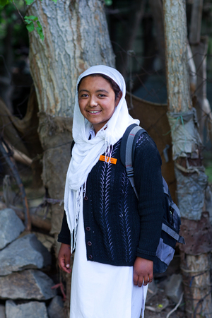 miling Balti student girl poses for a photo during her break time on June13, 2012 in Turtuk Village, Ladakh, India