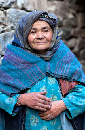 TURTUK, INDIA - JUNE 13, 2012: Muslim woman from Baltistan poses for a photo in Turtuk village, Ladakh, Jammu and Kashmir State, North India