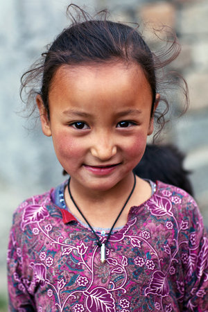 Balti shoolgirl poses for a photo during her break time on June 13, 2012 in Turtuk Village, Ladakh, India. Turtuk village opened to foreign tourists in 2010. Editorial