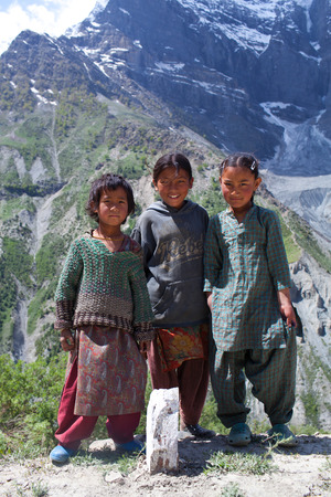 LADAKH, INDIA - JUNE 9, 2012: Villagers children poses for a photo on the road from Manali to Leh in Ladakh, India