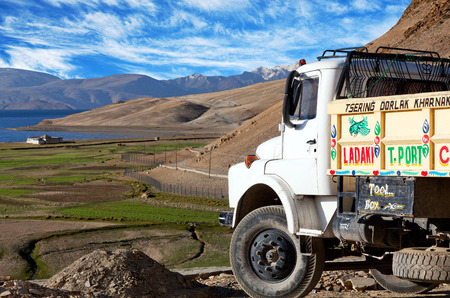semitruck: LADAKH, INDIA - JUNE 20, 2012: Indian truck driving on the road in Ladakh, India. Indian and Pakistani truckers make it a competition as to who has the most fabulous truck. Editorial